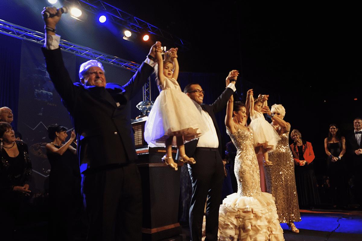 Trevor and Lexi Baker Celebrating on Stage